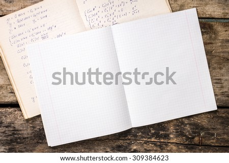 Exercise book with work book on old table. Top view image - stock photo