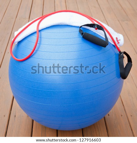 Exercise equipment for healthy lifestyle - fitness ball, expander and towel for outdoor workout. - stock photo