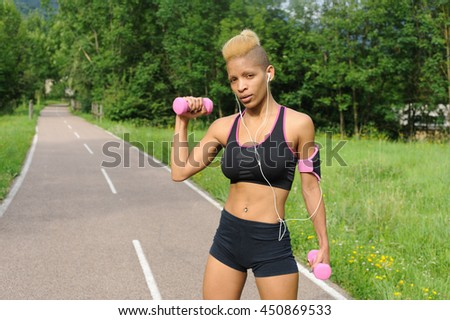Exercise with dumbbells - stock photo