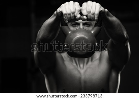 Exercise With Kettle Bell - Athletic Man Workout With Kettle Bell - stock photo