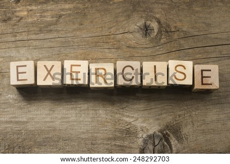 exercise word in vintage wooden blocks on a wooden background - stock photo