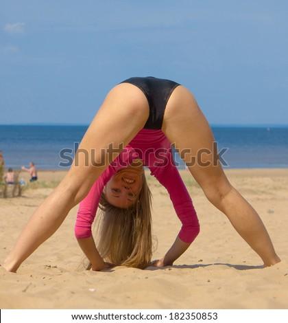 Exercising Stretching Beach  - stock photo
