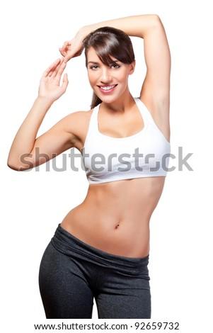 Exercising woman stretches - stock photo