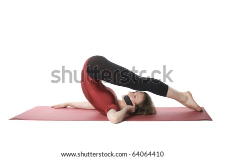 Exercising woman talking on cellphone, studio shot - stock photo