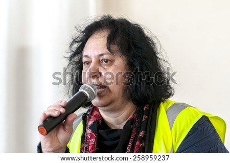 EXETER, ENGLAND - MARCH 7, 2015: Suaad George, from Devon United Women, addresses the audience at Exeter Mosque at the Walk for Peace through the city of Exeter to celebrate International Women's Day - stock photo