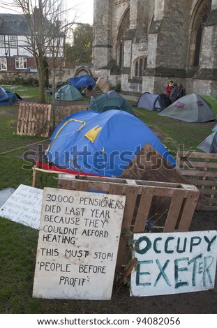 EXETER - JANUARY 28: Signs and tents in the Occupy Exeter camp  on January 28, 2012 in Exeter, UK - stock photo