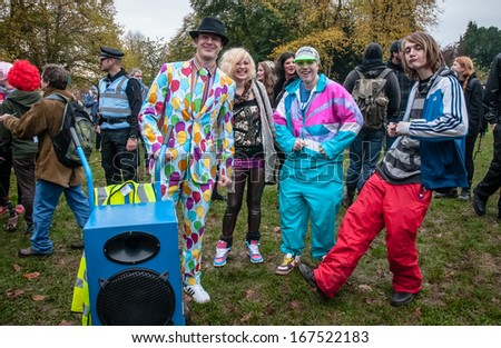 EXETER - NOVEMBER 16: Young adults dressed in disco clothes during the Exeter Together march and diversity festival on November 16, 2013 in Exeter, Devon, UK - stock photo