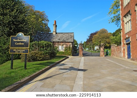 EXETER, UK - SEPTEMBER 12 2014: Signs and gate at the main entrance to Northernhay Gardens, Devon. These gardens on the northern side of Rougemont Castle are the oldest public open space in England. - stock photo