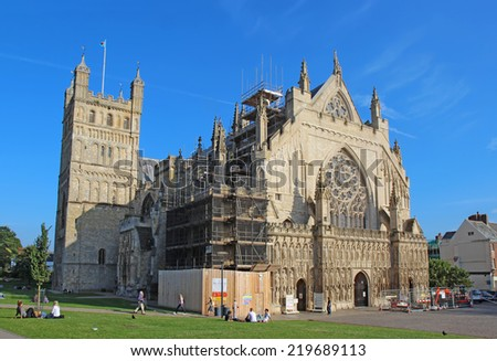 EXETER, UK - SEPTEMBER 12 2014: The Cathedral Church of Saint Peter at Exeter. Originally built around 1400, this city landmark has several unique features and is now undergoing exterior renovations. - stock photo