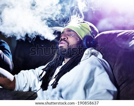 exhaling a big puff of marijuana smoke - stock photo