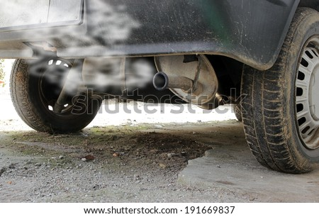 exhaust pipe of an old car - stock photo
