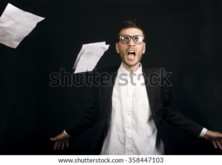 Exhausted businessman throwing documents  - stock photo