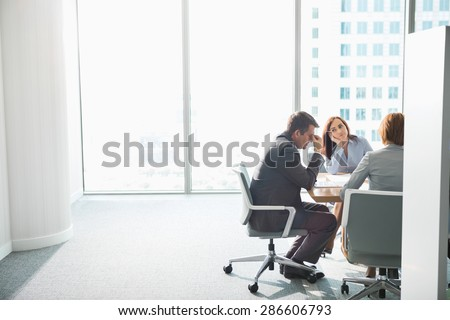 Exhausted businesspeople in meeting - stock photo