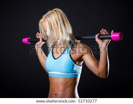 Exhausted sportswoman holding her fitbar - stock photo