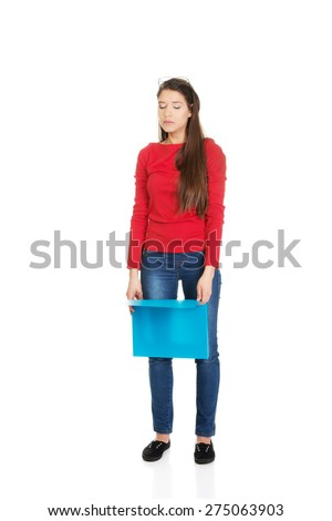 Exhausted student woman holding blue folder. - stock photo