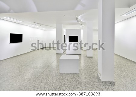 exhibition gallery, wall mounted art with museum style lighting, the art has been removed and replaced. There are path for the frame - stock photo