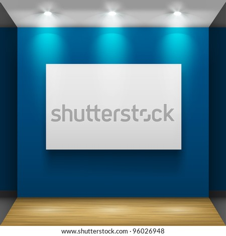 Exhibition hall with wooden floor and the three frames on the wall, illuminated by floodlights. - stock photo