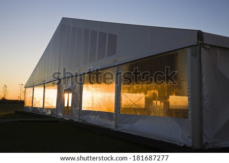 Exhibition tent during sunrise - stock photo