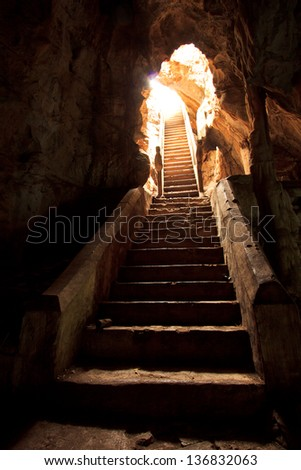 Exit of a cave ancient in thailand - stock photo