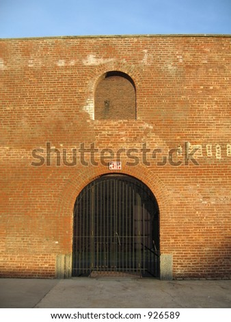 exit sign on outside of wall, strangely - stock photo