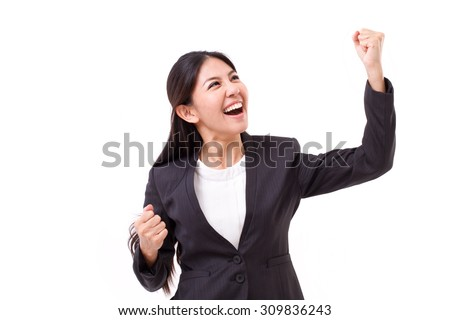 exited, successful business woman looking up - stock photo