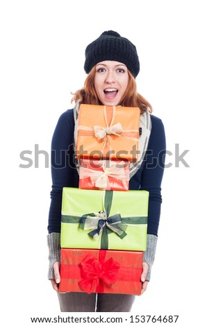 Exited woman in winter clothes holding many presents, isolated on white background. - stock photo