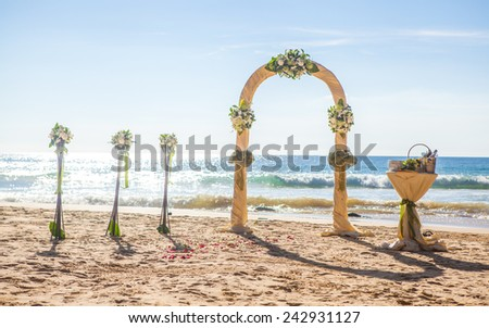 exotic ceremony wedding european style arch on the tropical beach  - stock photo