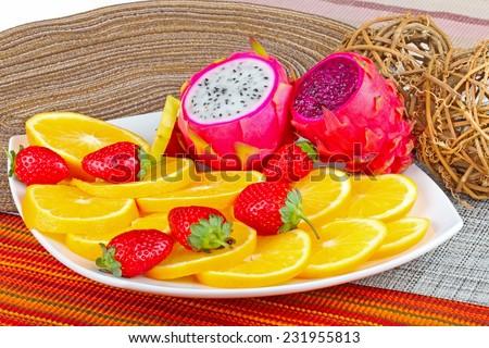 Exotic Fruit Dish with Dragon Fruit, pitahaya,strawberri es and orange slices - stock photo