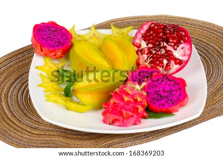 Exotic Fruit Dish with pitahaya,slice of a ripe pomegranate and carambola  - stock photo