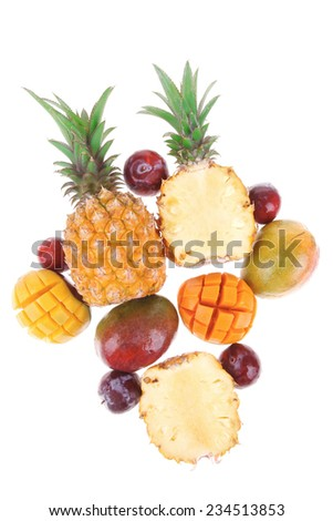 exotic fruit food - a lot of fresh raw tropical fruits include pineapple mango and red plums isolated over white background - stock photo