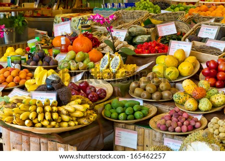 Exotic fruits on a market - stock photo