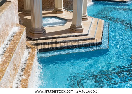 Exotic Luxury Swimming Pool Water, Hot Tub and Architecture Abstract. - stock photo