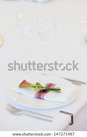 Exotic theme table setting. Decor with fresh calla - stock photo