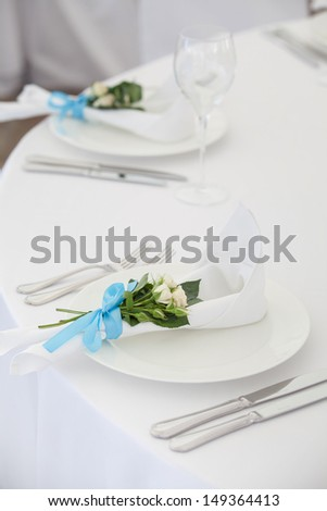 Exotic theme table setting. Decor with fresh rose - stock photo