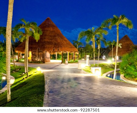Exotic tropical bungalow ( house) at dawn (night) time. Mexico - stock photo