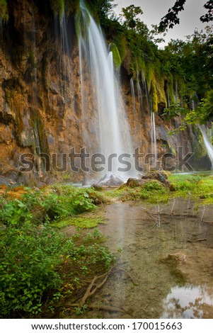 Exotic Waterfall in deep forest - stock photo