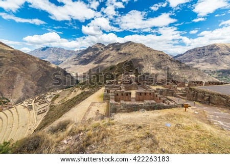Expansive view of the Sacred Valley, Peru from Pisac Inca site, major travel destination in Cusco region, Peru. Ancient Inca ruins in the foreground. - stock photo