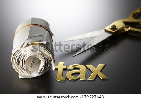 expense receipt ,tax,and scissors - stock photo
