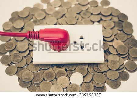 expensive electricity cost due to using too much energy consumption appliance - stock photo