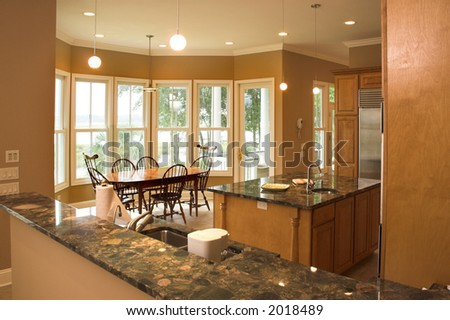 Expensive kitchen looking out into dining area - stock photo