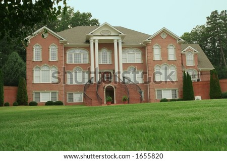 expensive mansion in the suburbs - stock photo