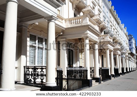 Expensive old fashioned typical Regency Georgian terraced town houses architecture in fashionable Kensington, London, England, UK - stock photo
