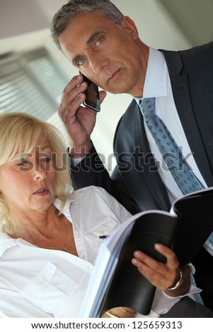 Expericned business couple - stock photo