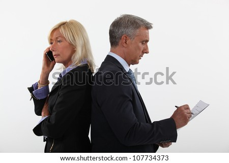 Experienced business couple - stock photo