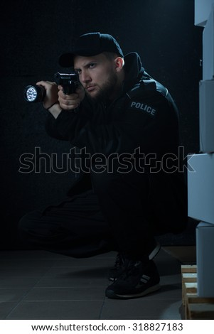 Experienced police officer working at secret police - stock photo
