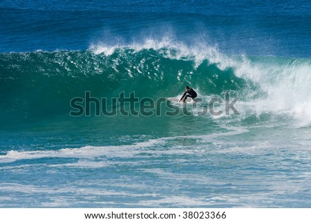 experienced surfer doing a turn on breaking wave - stock photo