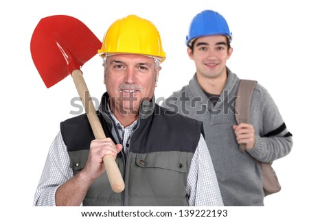 Experienced tradesman standing in front of his apprentice - stock photo