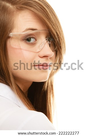 Experiments in laboratory. Chemist woman or girl student of chemistry or scientific researcher in goggles glasses isolated. - stock photo