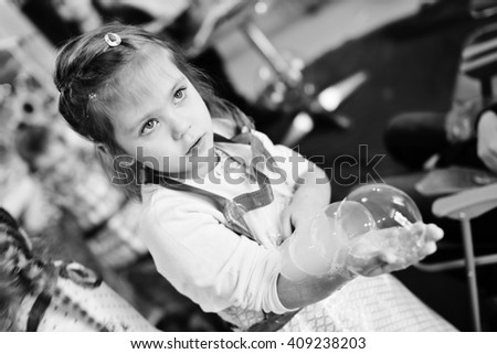 experiments with soap bubbles on the birthday party - stock photo