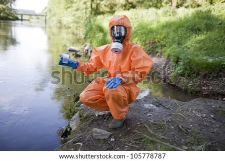Expert analysis of radioactive water - stock photo